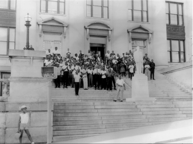 People posed in front of public building in protest
