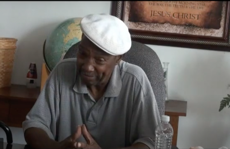 Man sitting in chair telling a story